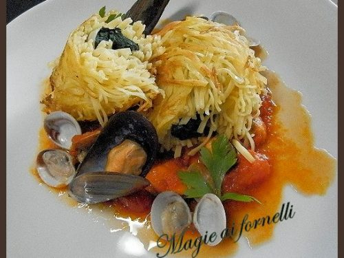 Cannellone di tagliolini,spinaci,zenzero e ragù di mare